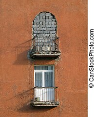 Two balconies - Two unalike balconies on wall of the old...