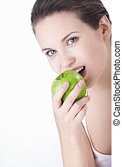 Dental - Attractive young girl eating an apple isolated