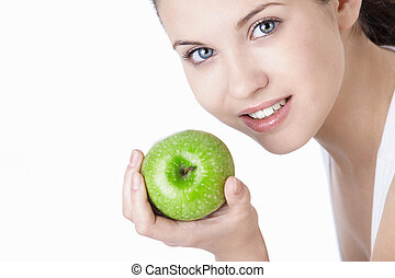 Dental care - Attractive young girl with an apple isolated