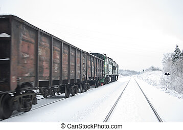 Freight train with coal (or gravel). After a plentiful...