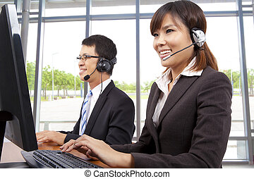 Smiling customer service representative in modern office with a headset