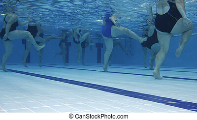 Aerobics class - A water aerobics class. Underwater picture.