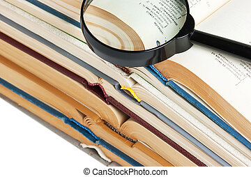 stack of open books, and Magnifier
