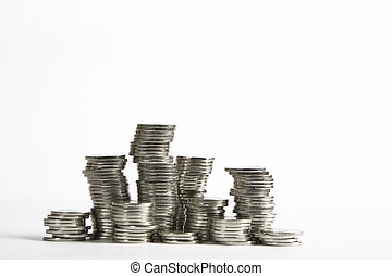 Stacks of silver coins on white background