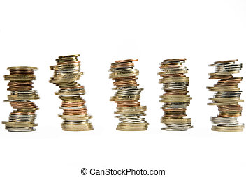 money coins stacked up - many money coins stacked up on a...