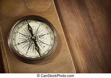 compass - vintage concept with old compass and atlas on...