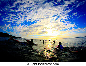 Line up infinity - Surfers paddling back to the line up at...