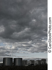 Storm clouds over the city - Urban landscape with storm...