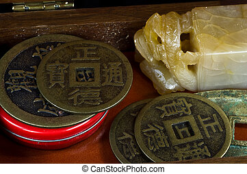 Curio box with Chinese alabaster stamp and ancient coins
