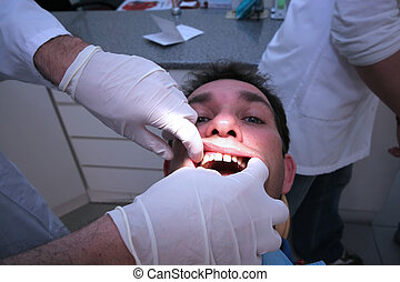Dental checkup - Man doing dental checkup
