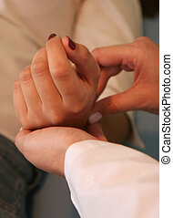 Not healthy - Hands of a doctor taking pulsation on pacients...