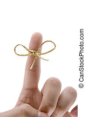 remember concept,  finger with gold tie on white background