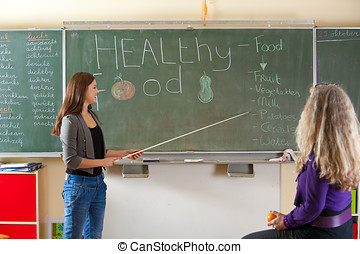Giving a presentation - Teenage girl in the classroom giving...