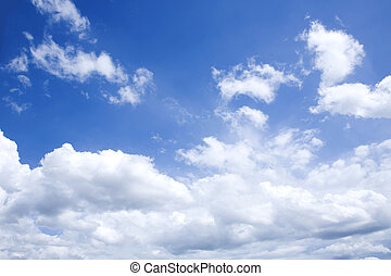bright blue sky with white clouds on sunny day - horizontal...