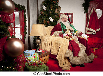 Santa Clause sitting in his chair at his place