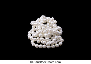 white pearl beads on black background