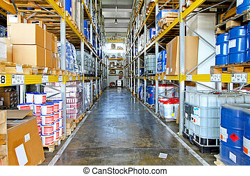 Storehouse corridor with goods and supplies at shelves