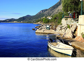 Alamy Nissaki harbour - The small harbour and taverna at...