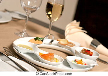 Starter or Entree of a french dish with fish, seafood mixed...