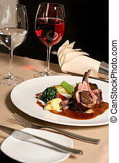 Lamb meal - restaurant table with a plate of lamb meal
