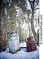 Nostalgic Milk Cans in Winter Landscape waiting for refill