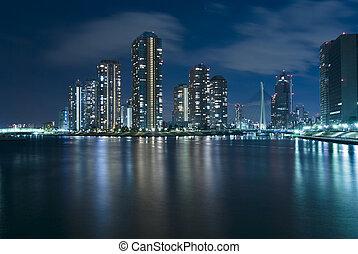modern Tokyo at night - modern Tsukuda district of Tokyo at...