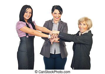 United team of business women standing with hands on top...