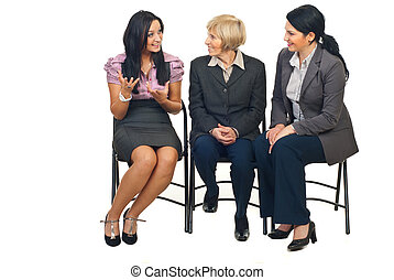 Happy discussion at conference - Three business women having...