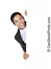 Young happy business woman holds blank billboard with ad space