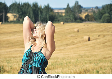 girl relaxing on a yellow field
