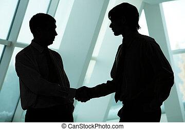 Men handshaking