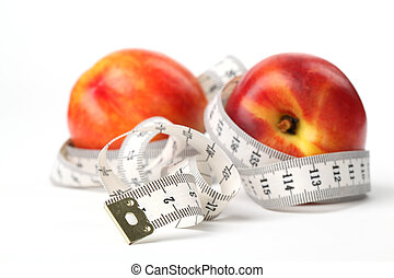 Tape measure and nectarines. Focus on tape measure