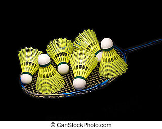 Badminton racket wit six yellow shuttlecock isolated on...