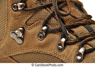 Trekking shoes and a white background