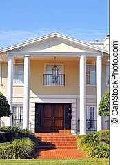 Elegant Entrance to Beautiful Colonial Home. Double columns...