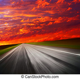 Road - Blurred asphalt road and red clouds