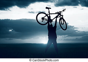 Rider - Man with bicycle lifted above him