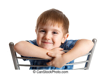 artistic boy sits on chairisolated on white background