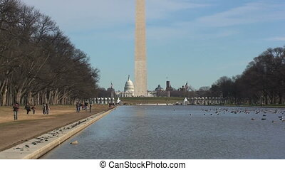 Washington Memorial with Capitol Building Next to Lake...