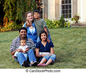 Happy Mixed-Race Family - A happy mixed-race family in their...