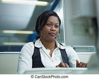 adult woman working in call center - female african american...