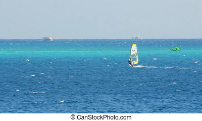 windsurfing - surfer on blue sea surface