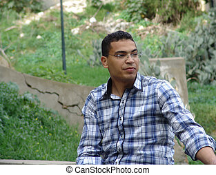 Tunisian man sitting in the tunisian forest.