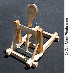 Catapult - Wooden catapult toy on dark background