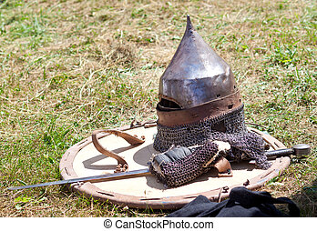 helmet, shield and sword - medieval knight armour ready to...