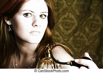 Woman with Perfume Atomizer - Beautiful young woman with...