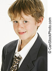 Smiling Boy in Big Suit - Adorable 7 year old boy in baggy...