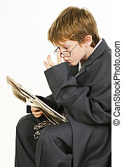 Boy in Baggy Suit Reading Newspaper - Adorable 7 year old...