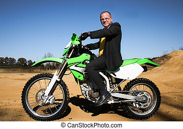 Business Man Suit Dirtbike - Business man in suit on...