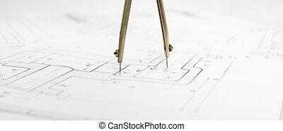Metal compasses against engineering drawing - Metal...